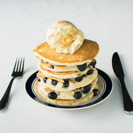a scoop on top pancakes